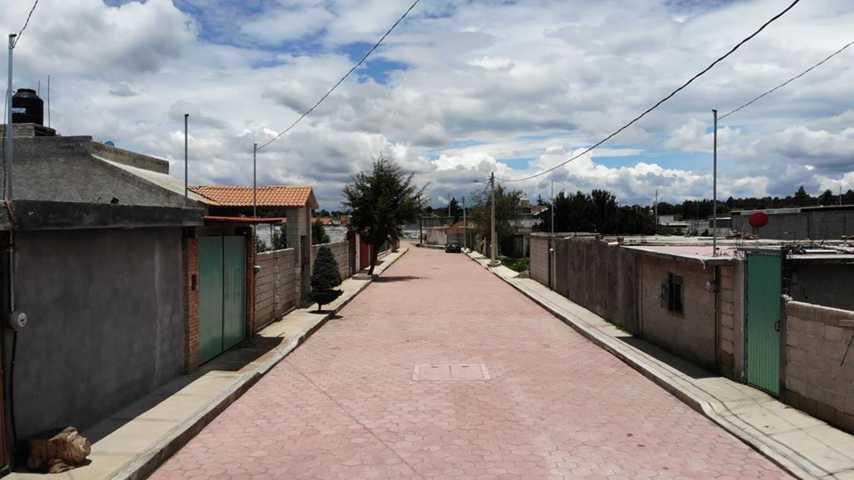 Vecinos agradecen adoquinamiento de la calle Revolución en la comunidad de San José Xicohténcatl de Huamantla