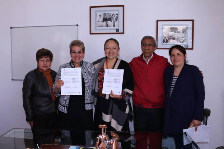 Firma convenio Texóloc y COSSIES