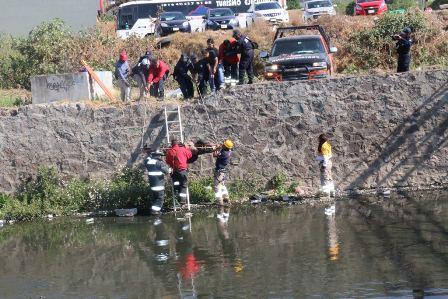Rescatan a ebrio sujeto tras haber caído al rio Zahuapan